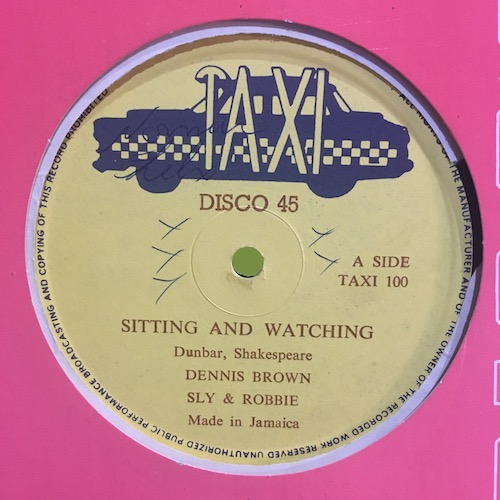 Dennis Brown / Sly & Robbie – Sitting And Watching